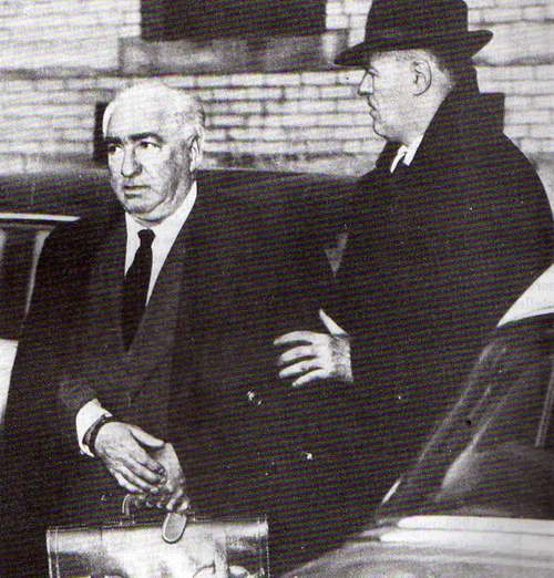 Reich being escorted to prison, March 1957