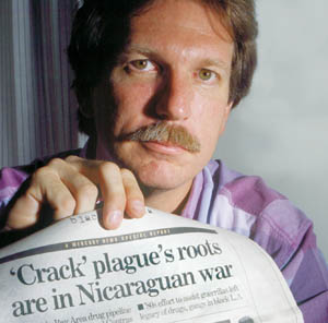 Journalist Gary Webb holding a copy of his Contra-cocaine article in the San Jose Mercury-News., From GoogleImages